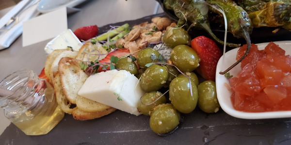 Calgary Bearspaw, Restaurant Flores and Pine charcuterie, platter olives honey peppers cheese