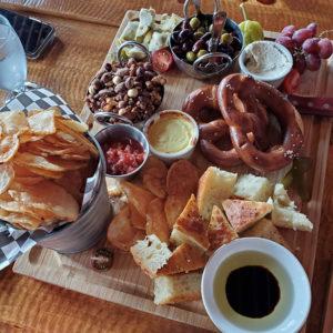 Banff Calgary restaurant Cliffhouse Bistro charcuterie preztels kettle chips olives